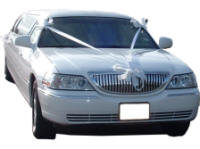 Cars for Stars (Shrewsbury) - Wedding Limo. White Lincoln stretched wedding limousine with white ribbons